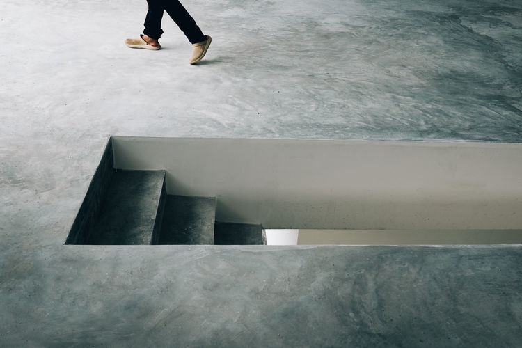 Low section of person walking on floor