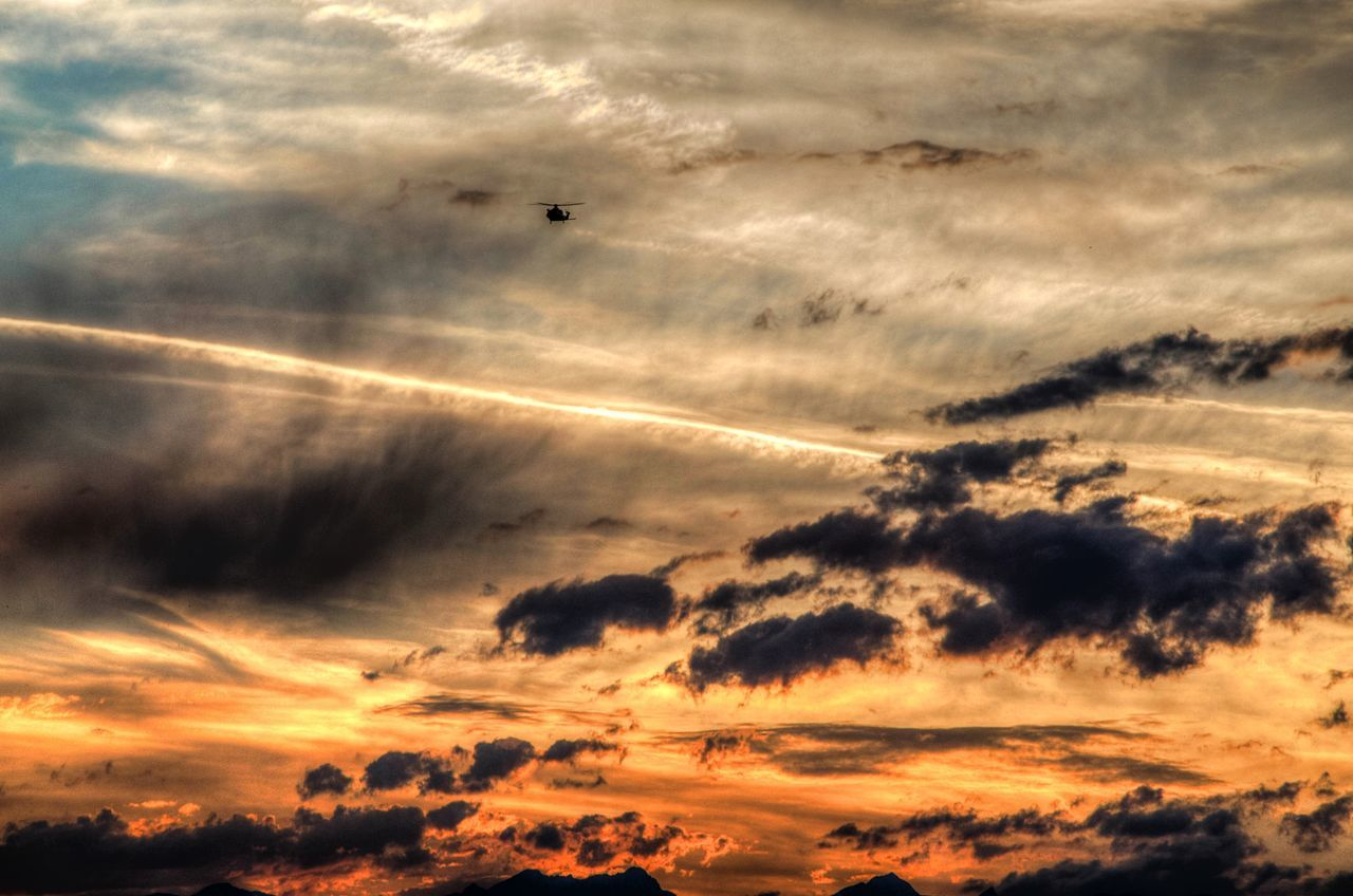 sunset, cloud - sky, nature, sky, silhouette, beauty in nature, scenics, dramatic sky, cloudscape, tranquil scene, no people, tranquility, outdoors, flying, low angle view, vapor trail, contrail, animal themes, bird, day