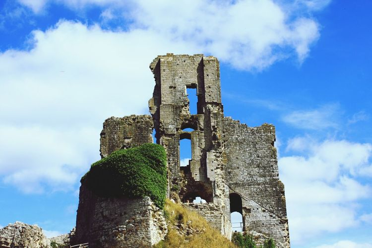 Low angle view of corfe castle against sky