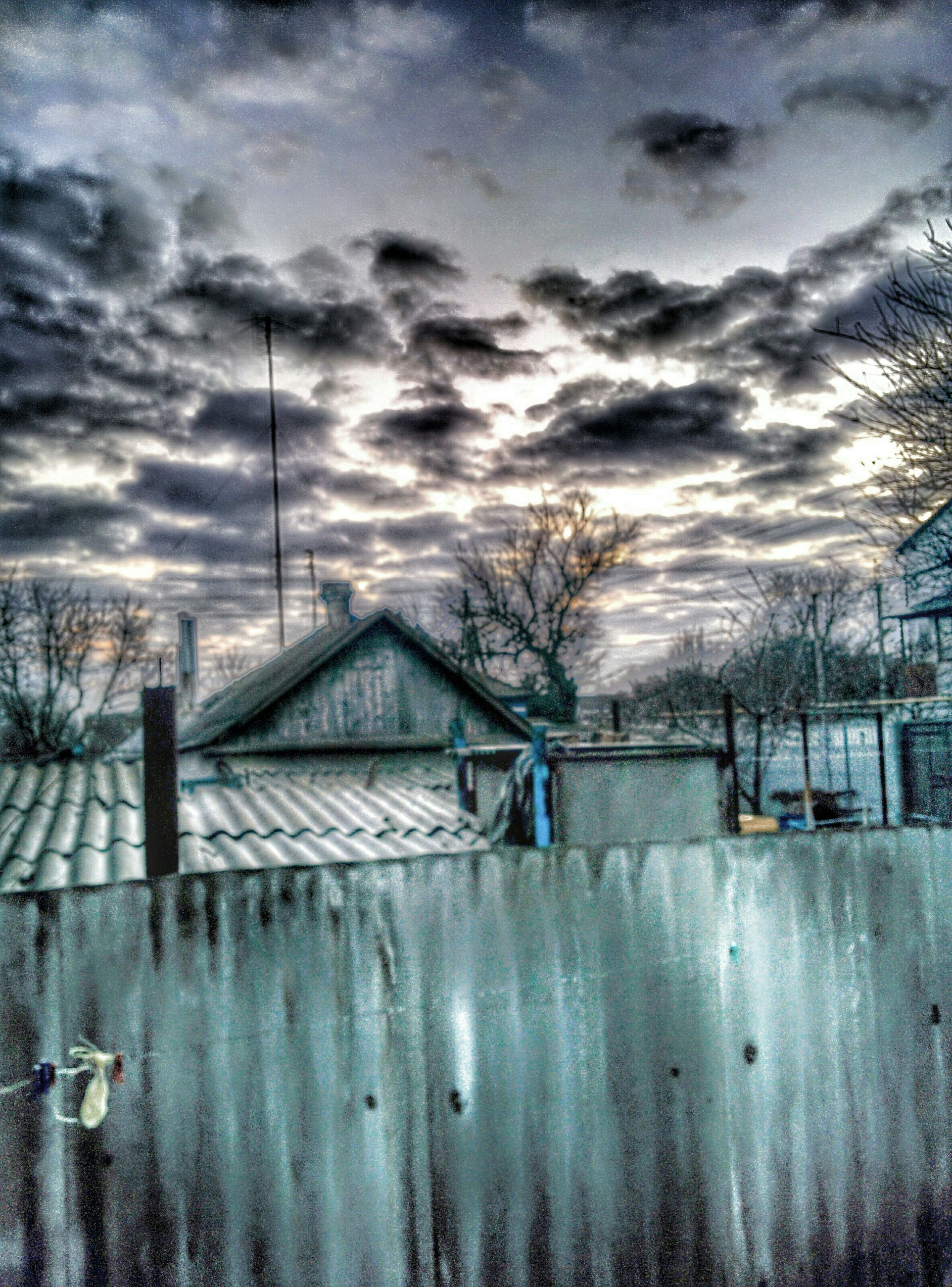 sky, cloud - sky, architecture, building exterior, built structure, cloudy, weather, house, cloud, fence, tree, bare tree, water, season, residential structure, sunset, no people, residential building, nature, outdoors
