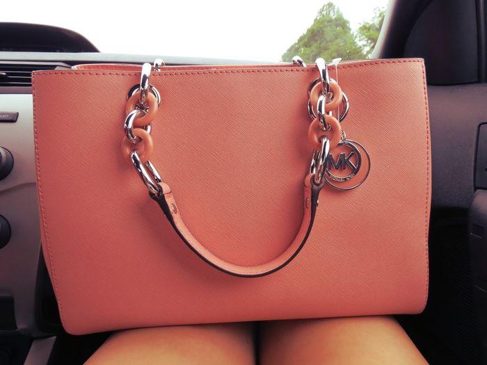 Close-Up Of A Pink Handbag On Lap