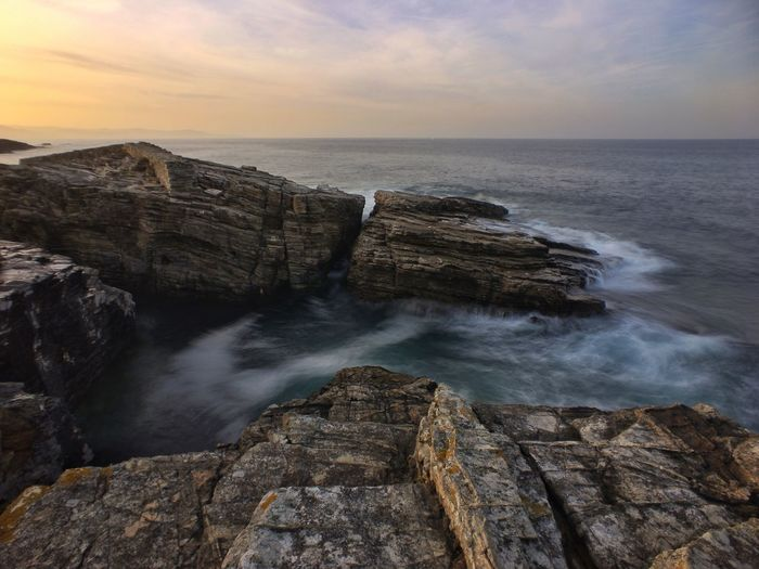 Water Sea Beauty In Nature Scenics - Nature Sky Horizon Over Water Rock Horizon Solid Rock - Object Motion Sunset Land Cloud - Sky Nature Long Exposure Tranquil Scene Tranquility No People