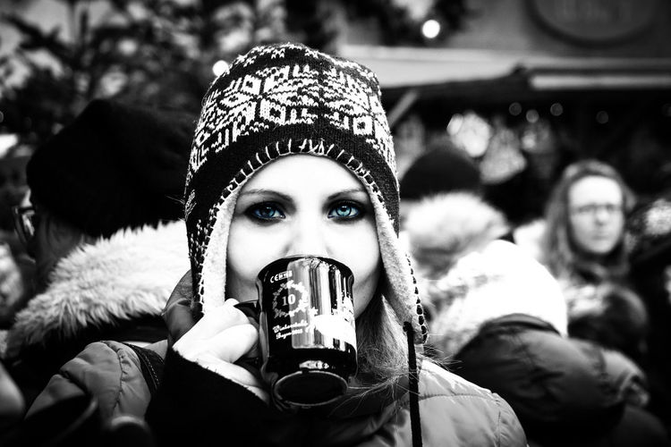 Portrait of young woman drinking in snow