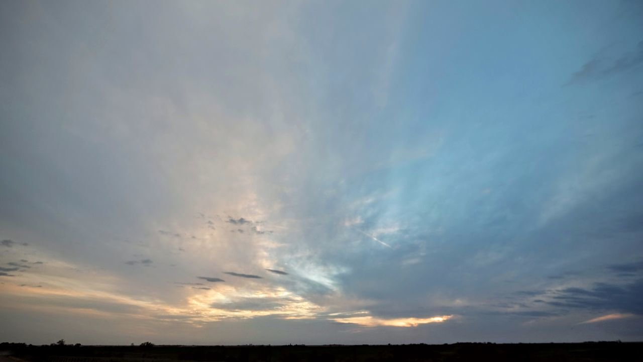 sky, nature, scenics, cloud - sky, tranquility, beauty in nature, tranquil scene, no people, outdoors, sunset, silhouette, low angle view, blue, landscape, day