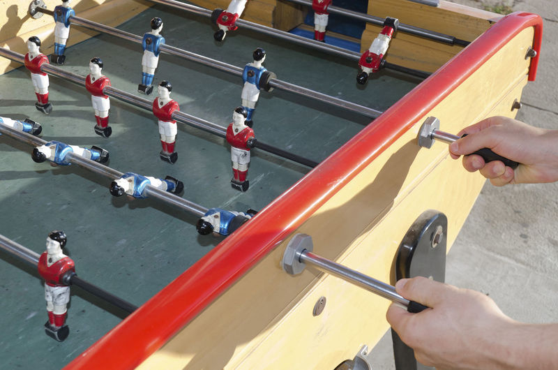 High angle view of person playing foosball