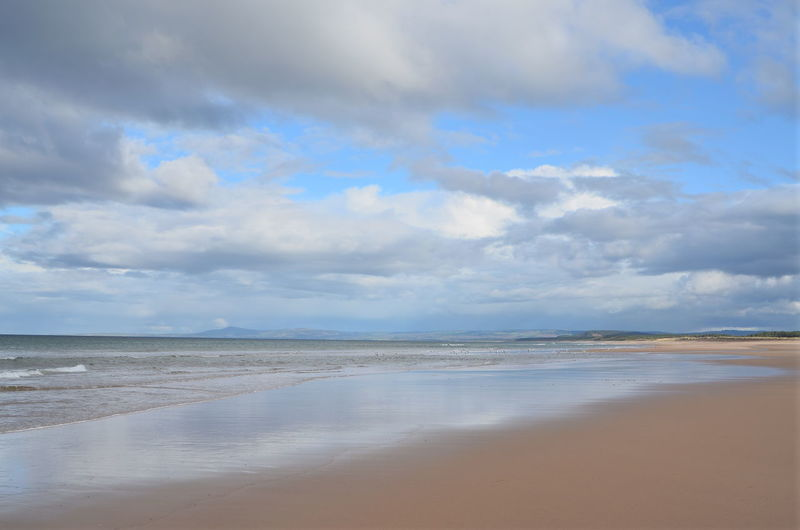 Moray Coast Sea Beach Water Land Sky Cloud - Sky Scenics - Nature Beauty In Nature Sand Environment Tranquility Landscape Nature Travel Destinations Coastline Tranquil Scene Tourism Water's Edge Travel Outdoors