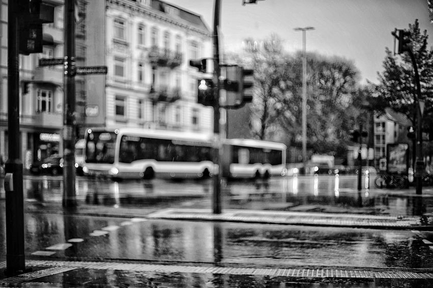 Wet Street in BNW Rainy Days Crossroad Cross Section Traffic Lights Puplic Transport Street City Transportation Wet Mode Of Transportation Water Architecture Reflection Building Exterior Built Structure Crossing City Street Motion Outdoors No People Car Rain Motor Vehicle Road Land Vehicle