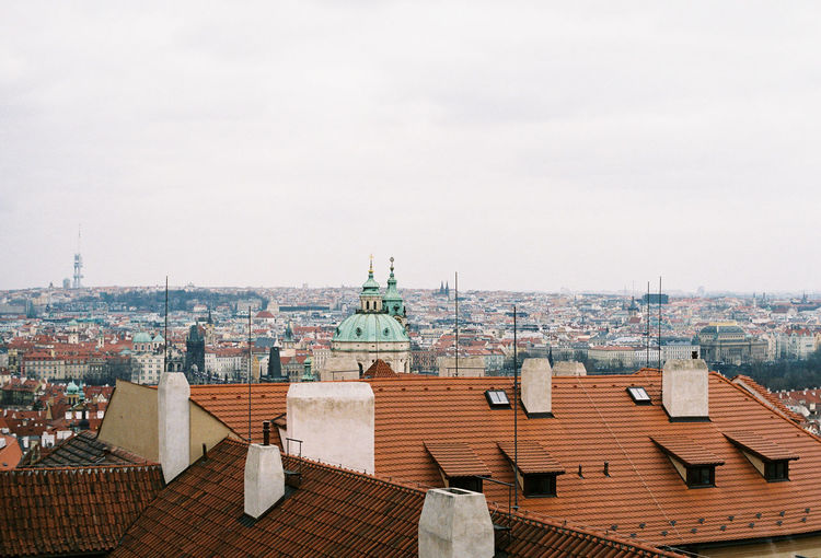 35mm 35mm Film Analogue Photography Prague Agfavista400 Analog Architecture Belief Building Building Exterior Built Structure City Cityscape Day High Angle View House Nature No People Place Of Worship Religion Residential District Roof Roof Tile Sky Spire  TOWNSCAPE