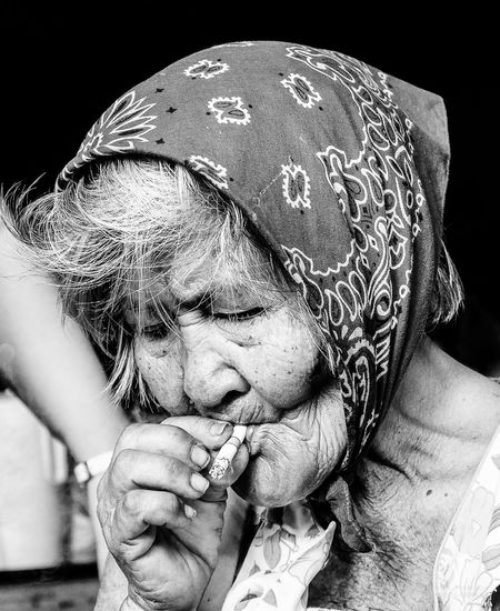 Close-Up Of Senior Woman Smoking Cigarette