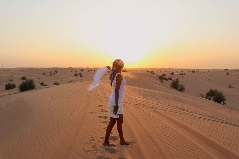 Land Sand One Person Sky Desert Nature Beauty In Nature Scenics - Nature Landscape Full Length Women Real People Standing Sunset Leisure Activity Lifestyles Adult Arid Climate Sand Dune Climate
