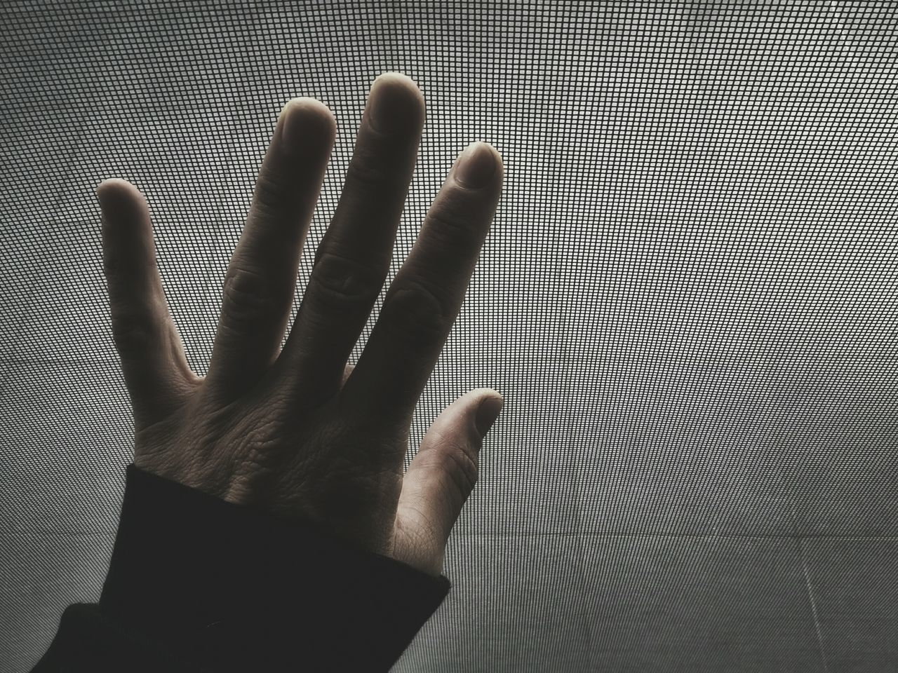 Cropped image of man hand against flooring