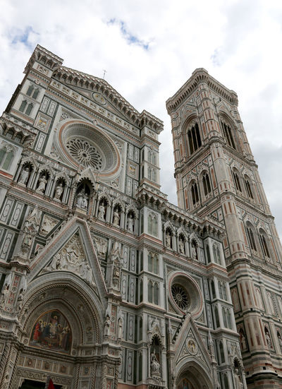 Florence Italy Facade of Duomo and the big bell tower called Campanile di Giotto in Italian language with wide angle lens Cathedral Duomo Duomo Di Firenze Façade Firenze Florence Italy Giotto Campanile, Firenze, Giotto's Bell Tower Giottos Renaissance Tuscan Tuscany Building Famous Place Fiorentina Fiorentino Florence Giotto Giotto Campanile Giotto's Cattedral Italian Italy Landmark Monument Santa Maria Del Fiore