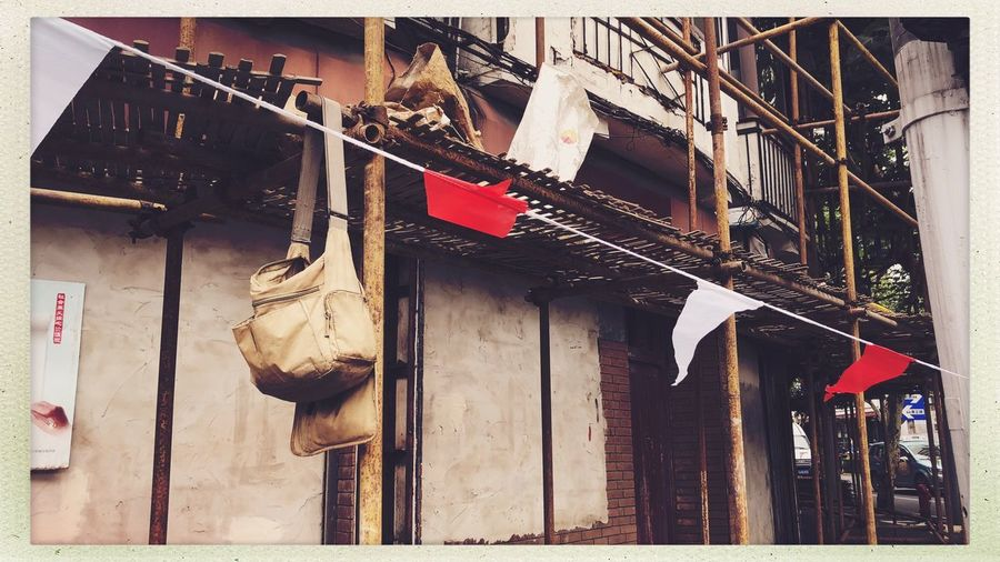 Citylife Streetphotography Transfer Print Auto Post Production Filter Hanging Built Structure Building Exterior Architecture No People Day Building Low Angle View Outdoors Lighting Equipment Decoration Clothing Nature Residential District Celebration House Wall Representation