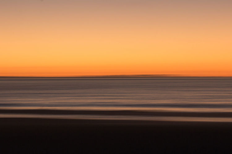 Llandudno Beach on a Slow Shutter. Late March, 2019. Nature Outdoors Sunset Sea Sky Scenics - Nature Water Horizon Horizon Over Water Tranquility Beauty In Nature Tranquil Scene Land Beach Copy Space No People Dusk Orange Color Clear Sky Shutterspeed Slow Shutter Blurred Motion Blue Blurred Background Cape Town South Africa Jonnynichayes Popular Photos My Best Photo Spring Travel Destinations Travel Explore Adventure Beauty In Nature