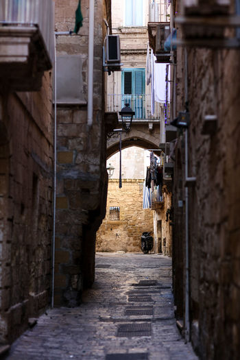 Light at the end of the tunnel Light At The End Of The Tunnel Taranto Taranto Vecchia Taranto, Italy Alley Alleyway Cityscape City Passage Old Town Old Outdoors Street Streetphotography Architecture Building Built Structure Building Exterior Narrow Day Residential District Town No People