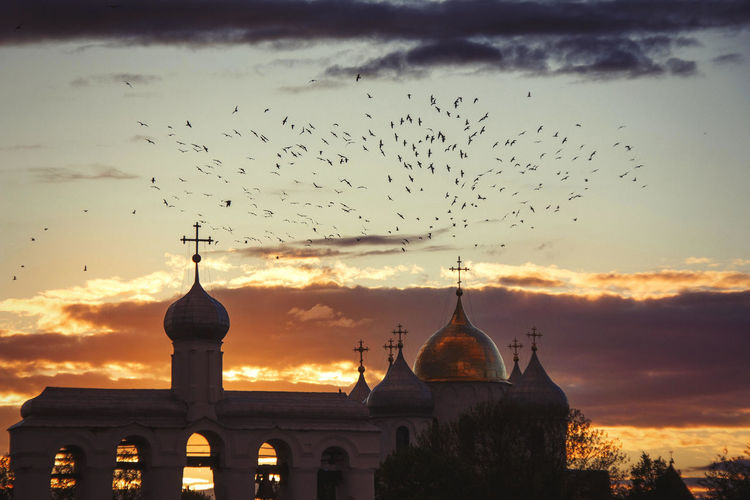 Animal Themes Animals In The Wild Architecture Bird Building Exterior Built Structure Cloud - Sky Day Flock Of Birds Flying Large Group Of Animals Nature No People Outdoors Place Of Worship Religion Silhouette Sky Spirituality Sunset