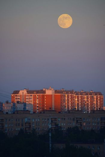Fool Moon at Sunset 🌇🌕 Sunset Evening Sky Fullmoon Building Exterior Architecture Moon Built Structure City Sky Night Full Moon Building No People Nature Cityscape Illuminated Outdoors Dusk Residential District Clear Sky Orange Color Planetary Moon Apartment