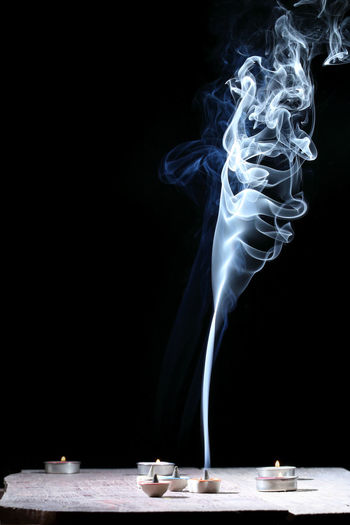 Incense cone or gum benjamin with abstract smoke, black background. Aromatherapy Asian  Burning Curve Smoke Spirituality Wave Abstract Aroma Aromatic Background Black Cone Cones Fragrance Fragrant Harmony Health Incense Odor Oriental Relaxation Scent Smell White