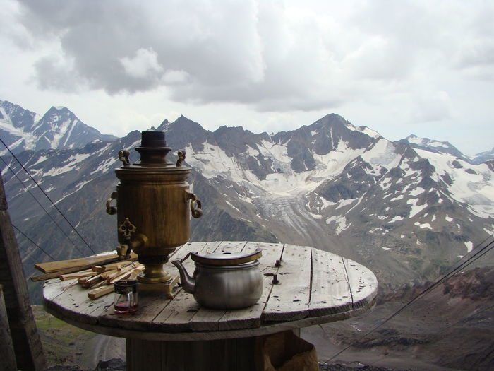 Samovar on the table with snowscaped mountains background