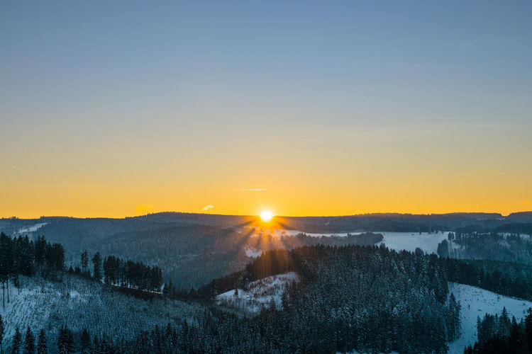 Sky Sunset Scenics - Nature Beauty In Nature Tranquility Tranquil Scene Sun Nature Snow Tree Environment Winter Landscape Cold Temperature Orange Color Sunlight No People Plant Lens Flare Outdoors Bright Black Forest
