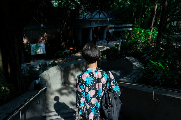 Rear view of young adults with short hair and wearing clothing summer collection walking alone in the nature park. Alone Asian Woman Sidewalk Summer Collection Adult Casual Clothing Clothing Garden Hairstyle Leisure Activity Lifestyles Light And Shadow Looking At View Nature One Person Outdoors Rear View Short Hair Standing Sunlight And Shadow Sunshine Tree Waist Up Walking Women HUAWEI Photo Award: After Dark EyeEmNewHere Be Brave