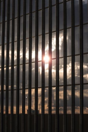 Silhouette Sunlight Reflection Sunlight Sun Pattern No People Sky Full Frame Backgrounds Nature Sunset Window Day Metal Barrier Architecture Protection Outdoors