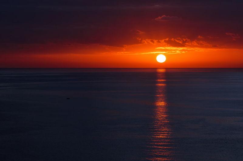 Scenic view of seascape against orange sky