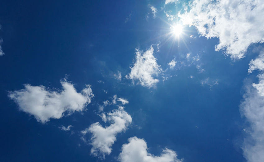 blue sky with clouds Against The Sky Sunlight Sunny Backgrounds Beauty In Nature Blue Blue Sky Blue Sky With Clouds Bluesky Cloud - Sky Clouds And Sky Day Idyllic Low Angle View Meteorology Nature No People Outdoors Scenics - Nature Sky Sunny Day Tranquil Scene Tranquility Wallpaper White Color