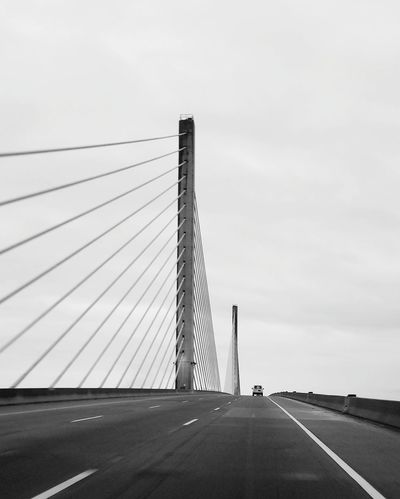 On The Road Again Business Finance And Industry Mytravels Day Outdoors Built Structure Delaware Memorial Bridge Architecture Art Is Everywhere No People Car On The Road My View My Driving Moment Black & White Travel Destinations Sky City Road Sign Cityscape Nature Golf Club