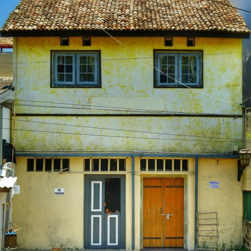 Building Exterior Built Structure Architecture Window Building Day Residential District House Roof No People Outdoors Nature Sunlight Yellow Old Entrance Door City Close-up Exterior