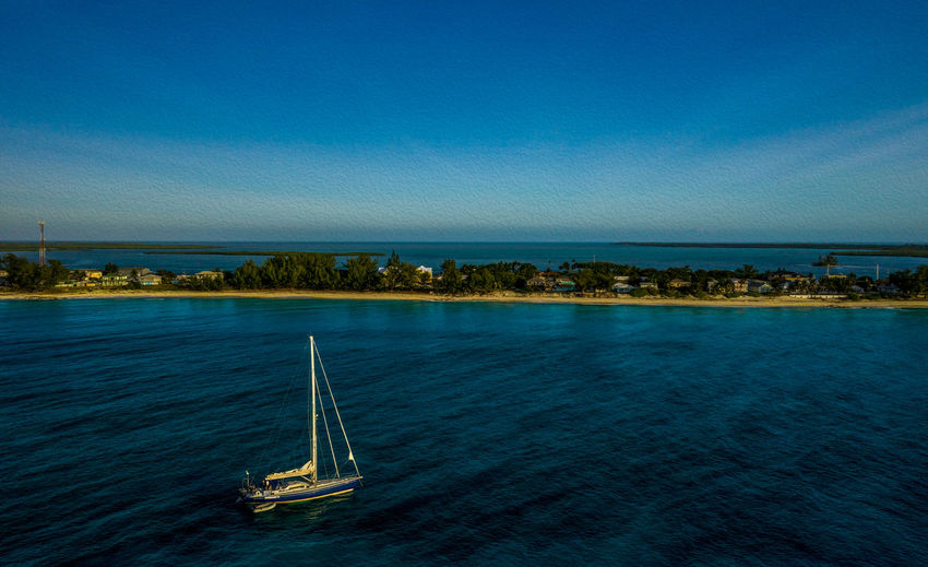 Bimini Blues Nautical Vessel Water Sea Transportation Mode Of Transportation Blue Sky Waterfront Nature Sailboat Sailing Beauty In Nature Yacht Tranquil Scene Day Travel Luxury Outdoors Scenics - Nature No People Idyllic