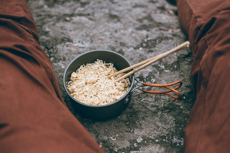 Hiking Bowl Chopstick Chopsticks Close-up Day Food Food And Drink Freshness Healthy Eating Hiking Food Holding Human Body Part Human Hand Lifestyles Men Noodle One Person Outdoors People Real People