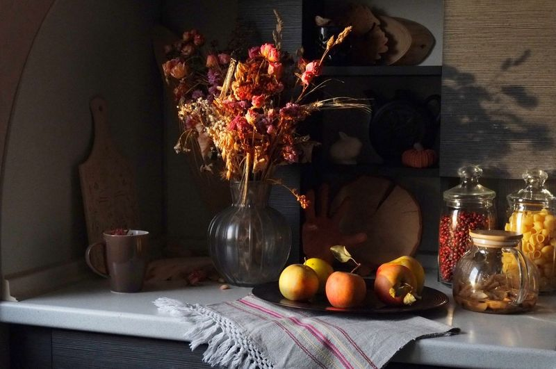 Various fruits in vase on table
