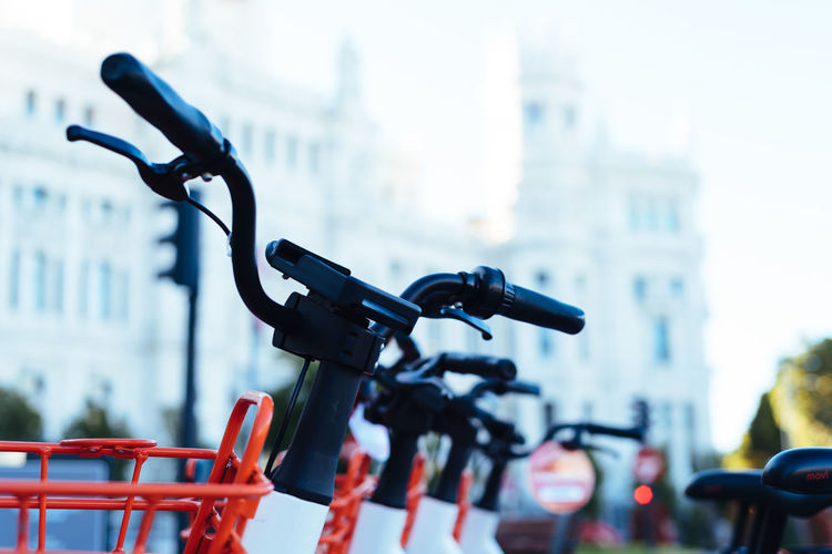 Close-up of bicycle parked in city