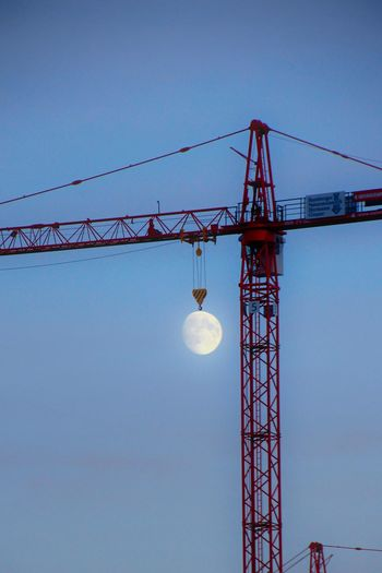 Moon Light Moon Architecture Sky Built Structure Machinery Crane - Construction Machinery Low Angle View Nature Tall - High No People Construction Industry Construction Site Clear Sky Tower Connection Development Blue Industry Metal Technology Outdoors The Street Photographer - 2019 EyeEm Awards