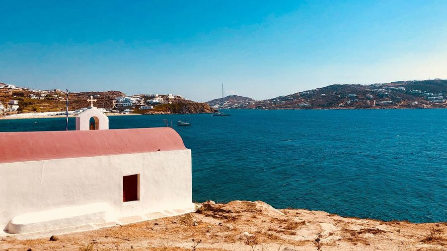 Church Sea Mediterranean  Mykonos Island Greece Greece Water Architecture Sky Building Exterior Sea Built Structure Blue Nature Day Building Clear Sky Sunlight No People Copy Space Beauty In Nature Outdoors Land Beach Bay