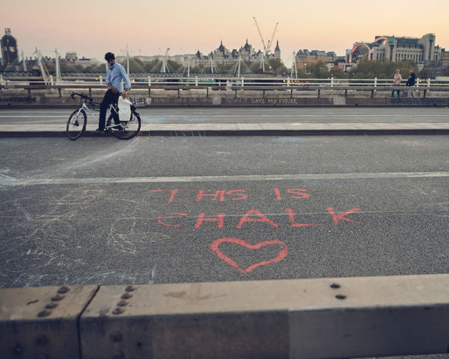 Extinction Rebellion London - Day 7 of Protests on Waterloo Bridge Extinction Rebellion Climate Change Protest Climate Change Streetphotography Street Photography People People Photography Transportation Text City Street Bicycle Communication Road Western Script One Person Sign Real People Mode Of Transportation Land Vehicle Day Capital Letter Lifestyles Architecture Marking Information Symbol Outdoors Riding