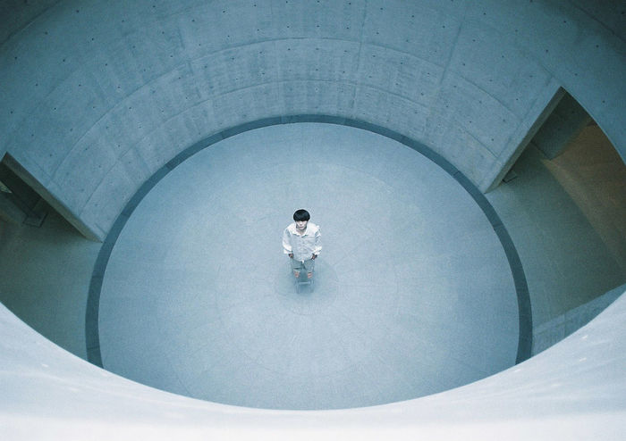 HIGH ANGLE VIEW OF WOMAN SITTING IN POOL