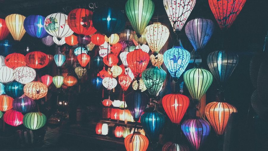 Colorful lanterns hanging for sale at night