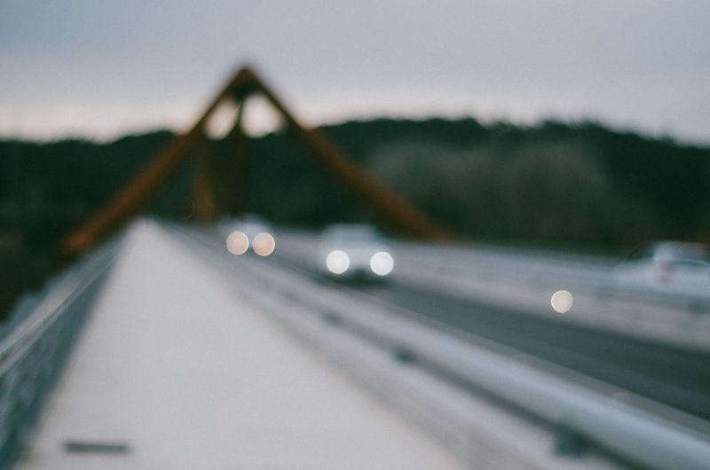 Defocused image of vehicles on bridge