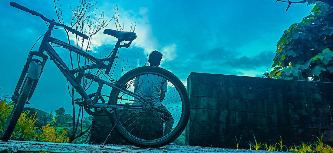 Low angle view of bicycle against sky