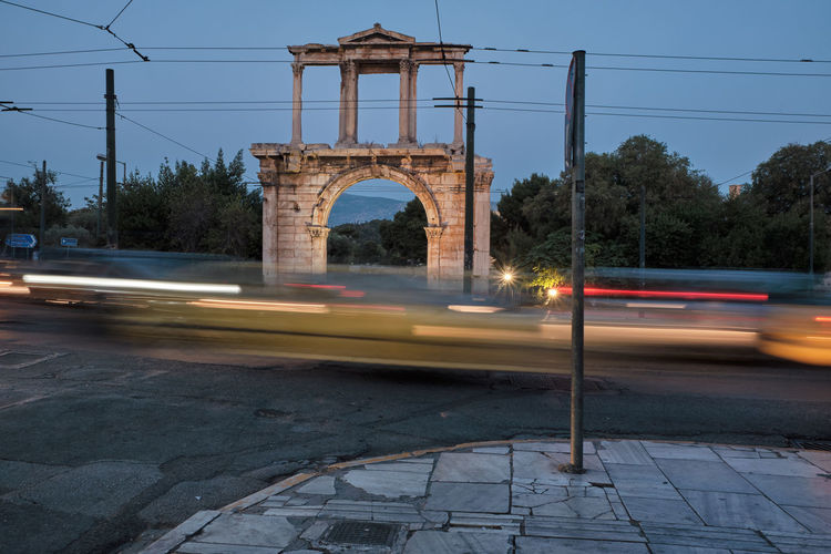 Ancient Gate Monument View City Athens Landmark History Stone Building Column Evening Architecture Roman Tourism Europe Arch Historical Travel Hadrian Night Culture Street Light Trail Town Classic Capital Sky Famous Temple Ancient Greece Archeology Light Trails City Construction Traffic Urban Speed Zeus Trails Long Exposure Light Hellenic Bus Archaeological Transportation Art Historic Transport Outdoor