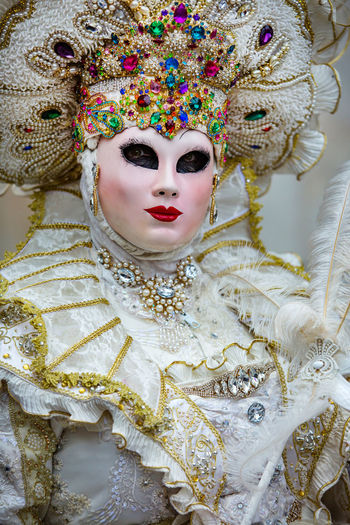 Woman wearing costume and mask during venice carnival