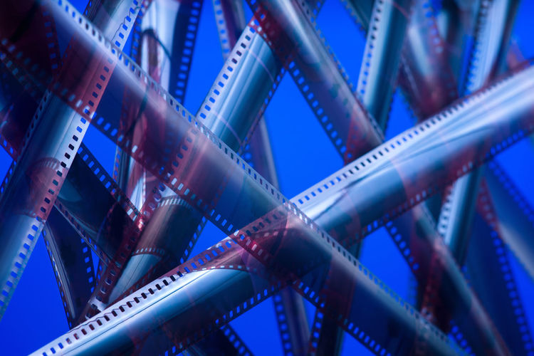 Analog film in neon lighting. Tangled movie plot Blue Camera Film Close-up Backgrounds Film Industry Technology Abstract Film Reel Arts Culture And Entertainment Selective Focus Photography Themes Film Connection Multi Colored Plastic Creativity MOVIE Content Media Plot Negative Analog Full Frame Editing Film