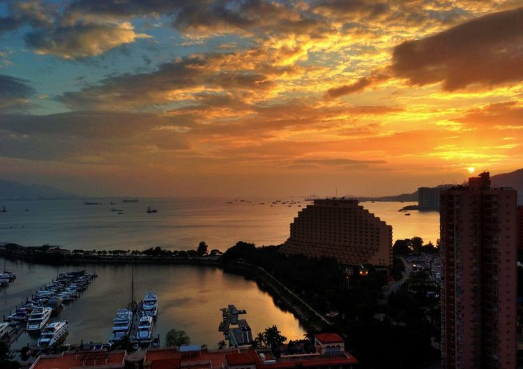 View of Hong Kong Gold Coast Hotel and harbor at sunset