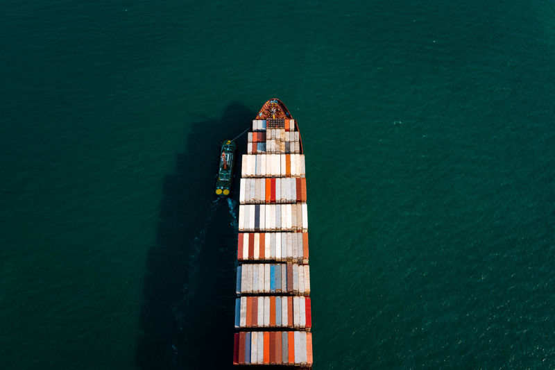 Aerial top view container cargo ship in import export business service commercial trade logistic