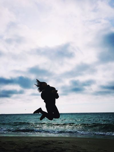 Sea Horizon Over Water Sky Water Cloud - Sky Beach Nature Motion Mid-air Full Length Outdoors One Animal Scenics Day Beauty In Nature Jumping No People Animal Themes Wave Jump Jumpshot Jumper Ocean Silhouette Women