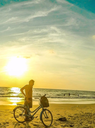 AloneBicycle Sunset Beach Sea Water Sky Cycling Summer Sunlight Silhouette People One Person Adult Outdoors Only Men Men Lifestyles One Man Only Nature Adults Only Alone But Not Lonely EyeEmNewHere