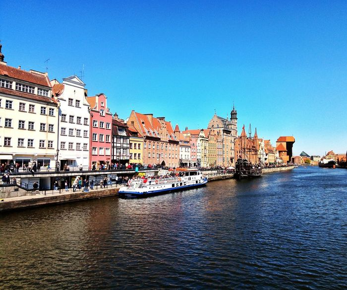EyeEm Selects Architecture No People Outdoors Blue Clear Sky Building Exterior City Day Cityscape Sky Gdansk Gdansk, Poland Sun Water River Motława