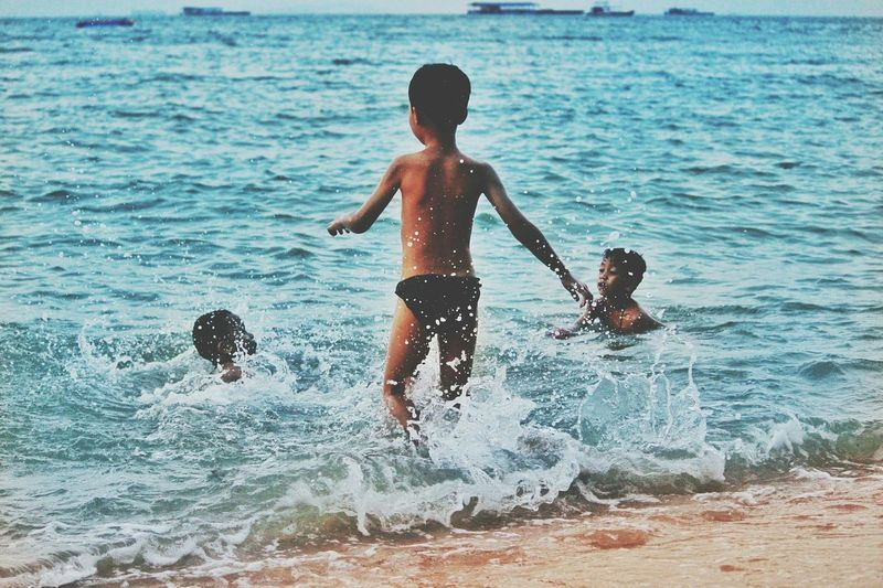 Child Childhood Boys Swimming Summer Wave Beach Outdoors Sea Children Only Water Sports Splashing Water Blue Water The Photojournalist - 2017 EyeEm Awards